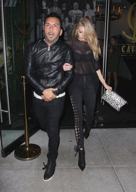 Charlotte McKinney and a male friend leave Catch restaurant in Los Angeles on February 9, 2017. (Photo by Bello/Splash News and Pictures)