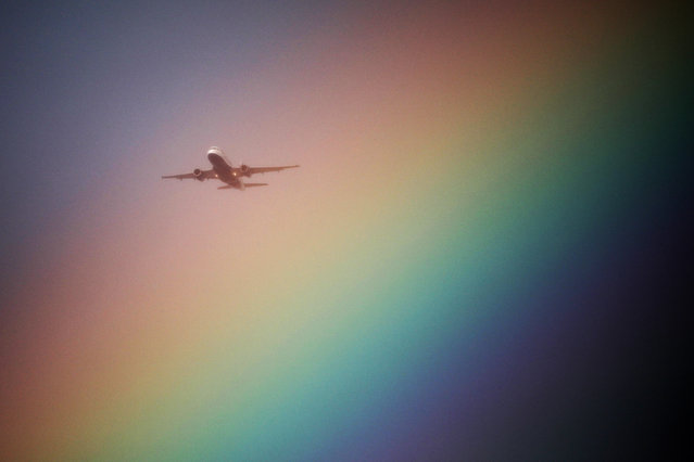 A British Airways aeroplane flies near a rainbow on its way to Heathrow Airport in London, Britain, July 23, 2017. (Photo by Kevin Coombs/Reuters)