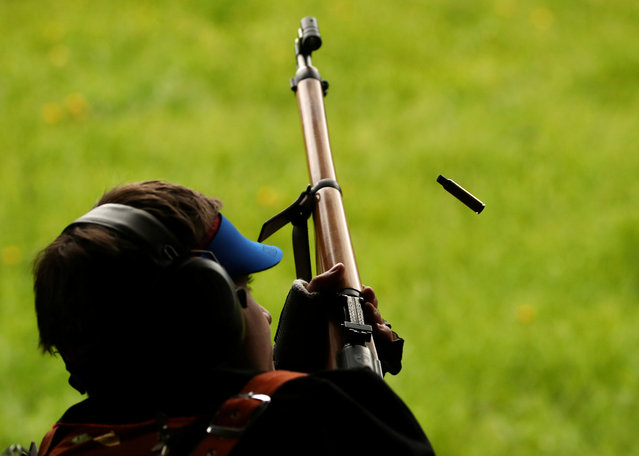A participant ejects a case from his musket during the Fribourg County 300m rifle final , ahead of a May 19 vote on a referendum to tighten weapons ownership laws in line with EU steps, at the shooting range in Romont, Switzerland on May 11, 2019. (Photo by Denis Balibouse/Reuters)