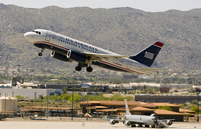 In this April 8, 2010 file photo, a US Airways plane takes off from Sky Harbor International Airport in Phoenix. American Airlines on Tuesday, May 12, 2015 said it plans to shut down the venerable carrier over a 90-day stretch that could begin as soon as July, which would mean a final departure around October. (Photo by Cheryl Evans/AP Photo/The Arizona Republic)