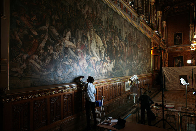 Conservators working on Daniel Maclise's murals The Meeting of Wellington and Blücher after the Battle of Waterloo and The Death of Nelson, in the Royal Gallery of the House of Lords on 19 April 2018. (Photo by Martin Godwin/The Guardian)
