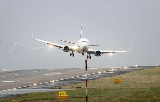 A plane is buffeted by the wind as it comes in to land at Leeds Bradford Airport as as flights were cancelled and commuters were warned they faced delays as winds reached nearly 90mph when Storm Doris battered many part of Britain. Thursday February 23, 2017. (Photo by Danny Lawson/PA Wire via AP Photo)