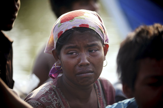 A rescued migrant weeps upon arrival Simpang Tiga, Aceh province, Indonesia, Wednesday, May 20, 2015. (Photo by Binsar Bakkara/AP Photo)