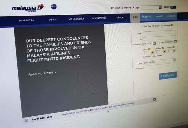 A sympathy message is displayed at the webpage of the Malaysia Airlines website, in Shah Alam, outside Kuala Lumpur, Malaysia, Tuesday, March 25, 2014. (Photo by Lai Seng Sin/AP Photo)