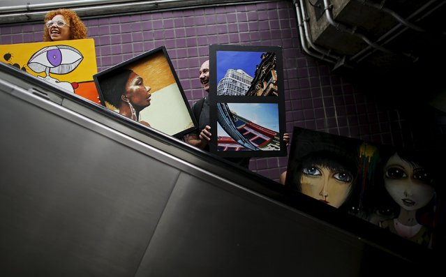 "Artists carry their creations on an escalator in Consolacao subway near Paulista avenue during a mobile exhibition named ""Walking Gallery"", in Sao Paulo May 23, 2015. (Photo by Nacho Doce/Reuters)"