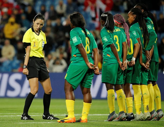 Referee Ri Hyang-ok talks to Cameroon players during the France 2019 Women's World Cup Group E football match between Canada and Cameroon, on June 10, 2019, at the Mosson Stadium in Montpellier, southern France. (Photo by Jean-Paul Pelissier/Reuters)