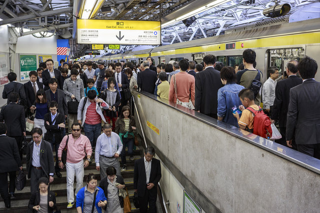 Commuters exit the platform at Shinjuku station, said to be the busiest railway station in the world. (Photo by Craig Ferguson/LightRocket via Getty Images)