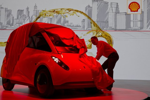 Andrew Hepher, Vice President of Lubricants Technology, Shell unveils the Shell Concept Car in Beijing, China, Friday, April 22, 2016. Built as proof of energy efficiency that can be achieved with the latest technologies, Shell unveiled the concept car ahead of the bi-annual Beijing Auto Show where the world's top car manufacturers will showcase their own upcoming products. (Photo by Ng Han Guan/AP Photo)