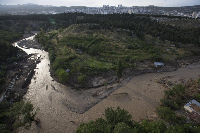 A view of the Vere river after Sunday's flooding in Tbilisi, Georgia, Monday, June 15, 2015. Workers and volunteers labored Monday in a flood-ravaged area of the Georgian capital to help victims while nervously watching for traces of dangerous animals that may have escaped the city zoo when it was inundated by the surging waters. Officials in the ex-Soviet republic said 14 people were confirmed dead. (AP Photo/Pavel Golovkin)