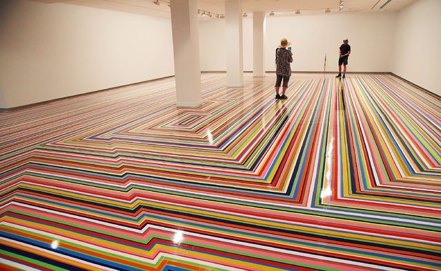 """Artist Jim Lambie's """"Zobop"""" floor work is displayed during a media preview as part of the 19th Beinnale of Sydney at the Museum of Contemporary Art on March 18, 2014 in Sydney, Australia. (Photo by Mark Metcalfe/Getty Images)"""