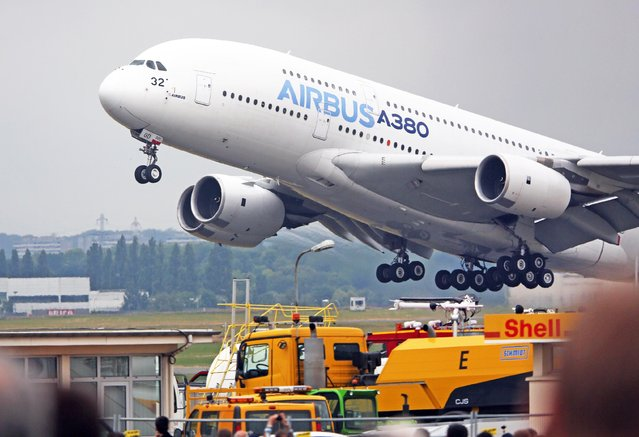An Airbus A380 takes off for its demonstration flight at the Paris Air Show in Le Bourget, north of Paris, Thursday June 18, 2015. Some 300,000 aviation professionals and spectators are expected at this weekends Paris Air Show, coming from around the world to make business deals and see dramatic displays of aeronautic prowess and the latest air and space technology. (AP Photo/Remy de la Mauviniere)