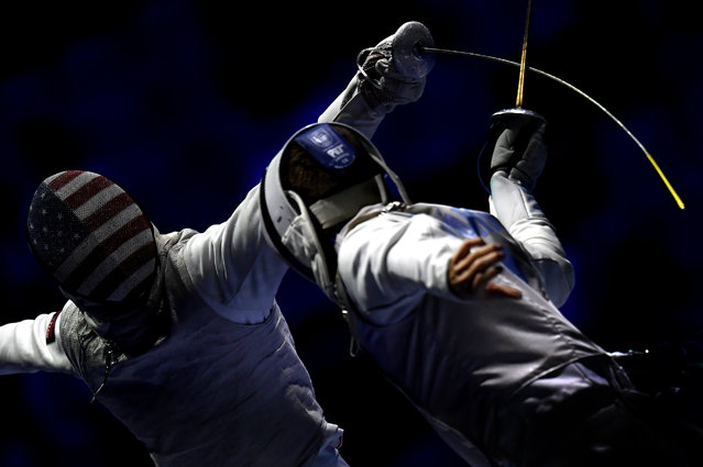 Tamas Meszaros, right, of Hungary and Race Imboden of United States fence during the men's team foil round of 16 match of the FIE World Fencing Championships in Budapest, Hungary, Monday, July 22, 2019. (Photo by Tibor Illyes/MTI via AP Photo)