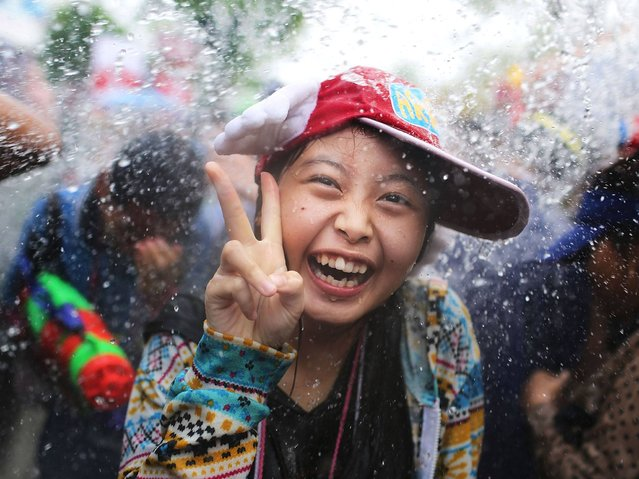 The festival has many different names specific to each country, such as Songkran in Laos and Thailand, Chaul Chnam Thmey in Cambodia, and Thingyan in Myanmar. The New Year is celebrated in other South Asian countries, based on the astrological event of the sun beginning its northward journey. (Photo by Taylor Weidman/Getty Images)