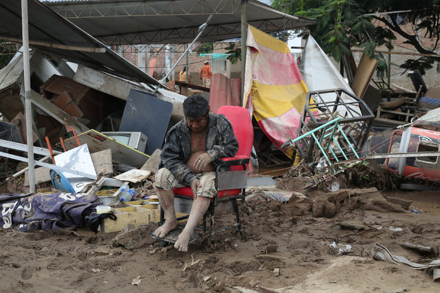 A resident sits outside his home after a massive landslide and flood in Viru, Trujillo, northern Peru, March 20, 2017. (Photo by Douglas Juarez/Reuters)