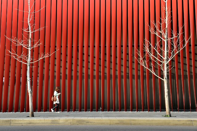 """""""Red tempo"""". Building of the outer wall of the red iron lattice-like in the Aomori Japan. """"Nebuta"""" is a float of summer festival tradition is on display in this building. Photo location: Aomori, Japan. (Photo and caption by Sho Shibata/National Geographic Photo Contest)"""