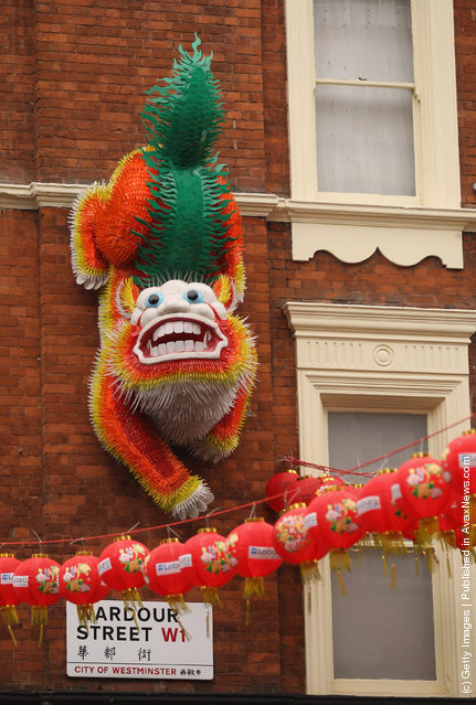 A large Chinese dragon adorns the wall of a building in the Chinatown area of Westminster
