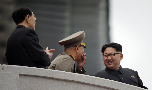 North Korean leader Kim Jong Un, right, smiles at Hwang Pyong So, the top political officer of the Korean People's Army, center, and Kim Yong Nam, the head of North Korea's parliament, left, as they watch parade participants at the Kim Il Sung Square on Tuesday, May 10, 2016, in Pyongyang, North Korea. (Photo by Wong Maye-E/AP Photo)