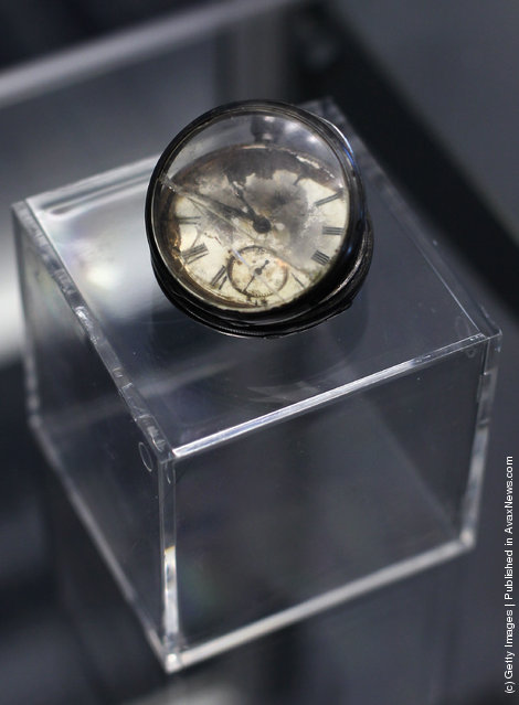A pocketwatch is seen among artifacts recovered from the RMS Titanic