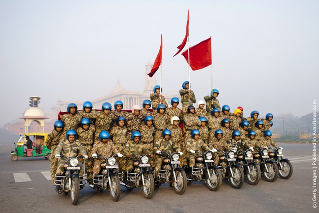 Indian soldiers practice their stunts on Royal Enfield motorcycles in preparation for the upcoming Republic Day parade