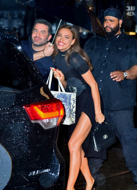 Model Irina Shayk shields herself from rain as she leaves the grand opening of Falconeri in SoHo of New York on October 16, 2019. (Photo by Backgrid USA)