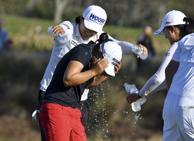LPGA players Amy Yang and Jin Young Ko rush to Sei Young Kim in celebration of her winning the 2019 CME Group Tour Championship at the Tiburón Golf Club in Naples, Fla. Sunday, November 24, 2019. (Photo by Chris Tilley/Naples Daily News via AP Photo)