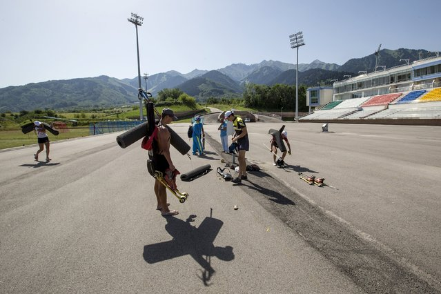 Athletes attend training session at the Ak Bulak Nordic Arena outside Almaty, Kazakhstan, July 16, 2015. (Photo by Shamil Zhumatov/Reuters)
