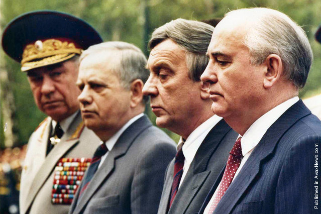 A few weeks before the Coup, Mikhail Gorbachev stands surrounded by his so-called friends, all of them soon to be leaders of the August Coup against him. Vice President Gennady Yanayev, second from right, became the most visible of the Coup leaders. Here, they are lighting the flame at the tomb of the unknown soldier outside the Kremlin wall in May of 1991