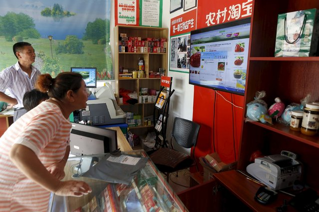 A customer shops at an Alibaba rural service centre in Jinjia Village, Tonglu, Zhejiang province, China, July 20, 2015. (Photo by Aly Song/Reuters)
