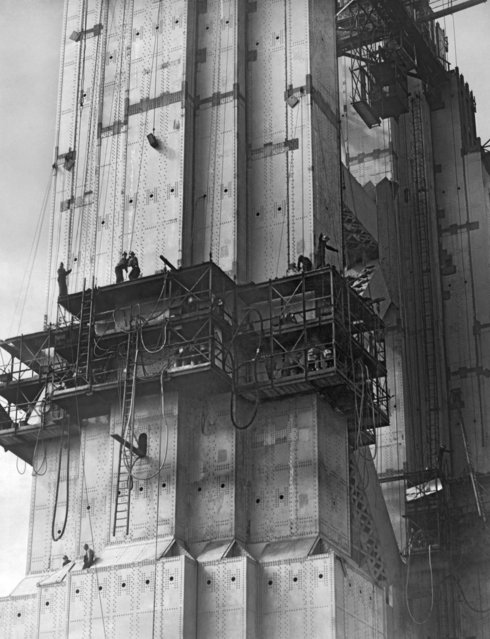 The Golden Gate Bridge under construction with riveters at work in cages on the South Tower, San Francisco, California, 1935. (Photo by Underwood Archives/Getty Images)