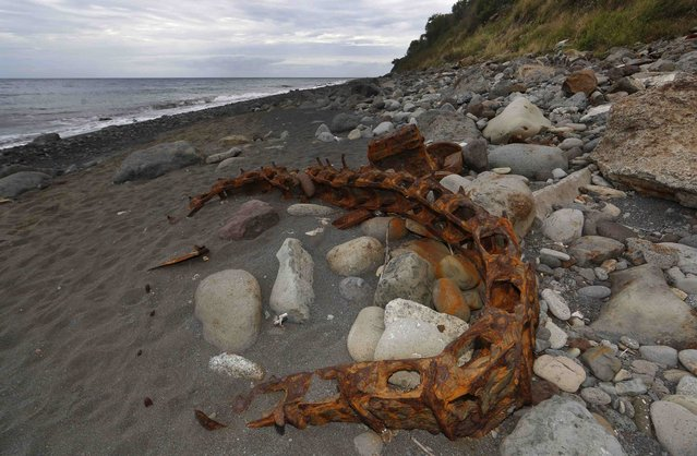 Debris that has washed onto the Jamaique beach in Saint-Denis is seen on the shoreline of French Indian Ocean island of La Reunion, August 3, 2015. On Sunday, a small piece of metal debris found washed up on a beach on Reunion was taken into police custody. (Photo by Jacky Naegelen/Reuters)