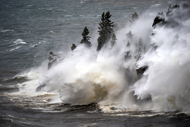 Waves pound the shoreline at Tettegouche State Park Thursday, April 11, 2019 at Silver Bay, Minn. Wind gusts were up to 50 milers per hour. (Photo by Brian Peterson/Star Tribune via AP Photo)