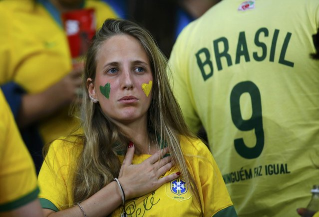 A Brazil fan reacts during the team's 2014 World Cup semi-finals against Germany at the Mineirao stadium in Belo Horizonte July 8, 2014. (Photo by Kai Pfaffenbach/Reuters)