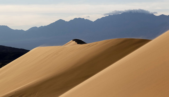Singing sand, the 150-metre-high by three-kilometre-long dune that generates a low-pitched, organ-like rumble in dry weather, is seen in Altyn-Emel national park in Almaty region, Kazakhstan, May 12, 2016 (Photo by Shamil Zhumatov/Reuters)