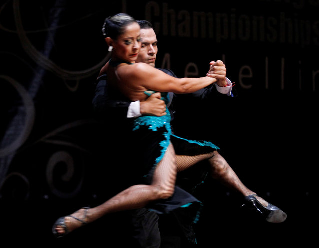 Edis Villa and Andres Martinez of Colombia perform during the World Tango Championship in Medellin, Colombia, June 19, 2016. (Photo by Fredy Builes/Reuters)