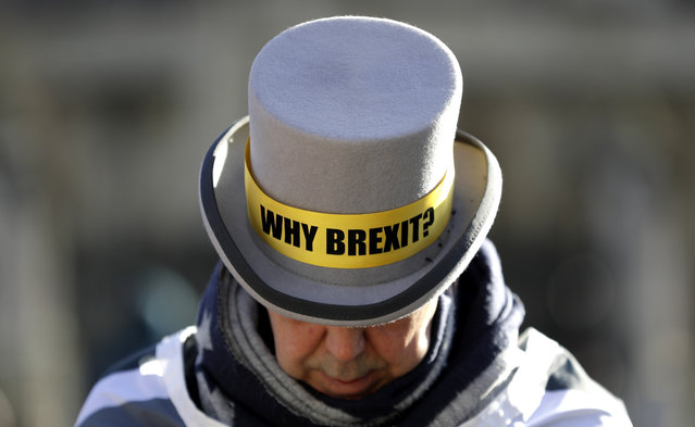 Why Brexit? written on the hat of Anti-Brexit campaigner Steve Bray as he stands outside Parliament in London, Wednesday, January 29, 2020. Britain officially leaves the European Union on Friday after a debilitating political period that has bitterly divided the nation since the 2016 Brexit referendum. (Photo by Kirsty Wigglesworth/AP Photo)