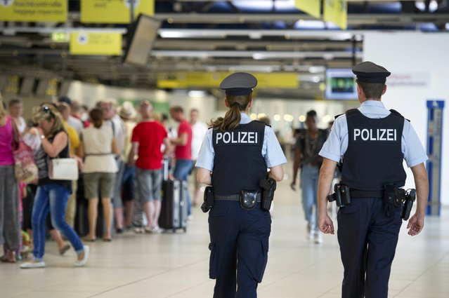 Two German federal police officers patrol during a security drill at Schoenefeld airport near Berlin, Germany August 12, 2015. (Photo by Stefanie Loos/Reuters)