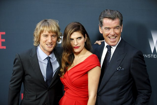 """Cast members Owen Wilson (L), Lake Bell (C) and Pierce Brosnan (R) pose at the premiere of the film """"No Escape"""" in Los Angeles, California August 17, 2015. (Photo by Danny Moloshok/Reuters)"""