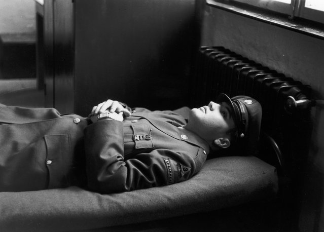 Portrait of American rock singer Elvis Presley (1935 - 1977), wearing a military uniform, lying on an army cot with his hands folded across his chest during his military service in Germany on January 10, 1958. (Photo by Hulton Archive/Getty Images)
