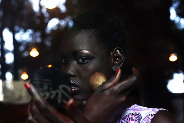 A South Sudanese model applies make-up during the Festival of Fashion and Arts for Peace in Juba August 9, 2014. (Photo by Andreea Campeanu/Reuters)