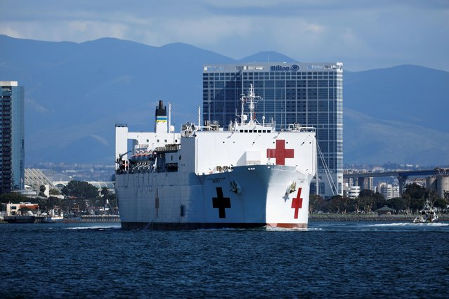 The USNS Mercy, a Navy hospital ship, departs the Naval Station San Diego and heads to the Port of Los Angeles to aid local medical facilities dealing with coronavirus disease (COVID-19) patients, in San Diego, California, U.S., March 23, 2020. (Photo by Mike Blake/Reuters)