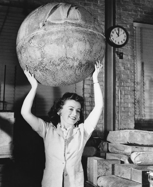 Mrs. Dorothy Barker easily holds a 29-inch sphere of the lightweight foam plastics in Pittsfield, Massachusetts July 19, 1944. (Photo by AP Photo)