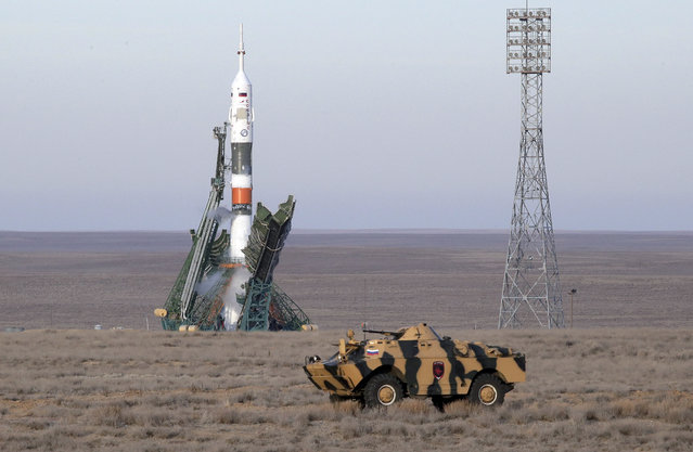 A police APC drives prior to the launch of Soyuz MS-11 space ship with U.S. astronaut Anne McClain, Russian cosmonaut Оleg Kononenko and CSA astronaut David Saint Jacques, members of the mission to the International Space Station at the Russian leased Baikonur cosmodrome, Kazakhstan, Monday, December 3, 2018. (Photo by Dmitri Lovetsky/AP Photo)