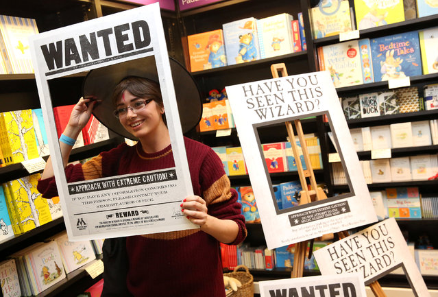 A fan poses for a photograph at an event to mark the release of the book of the play of Harry Potter and the Cursed Child parts One and Two at a bookstore in London, Britain July 30, 2016. (Photo by Neil Hall/Reuters)