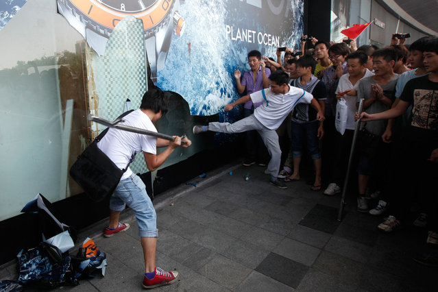 Demonstrators damage a window on a Japanese Seibu department store during a protest against Japan's decision to purchase the Diaoyu/Senkaku Islands, in Shenzhen, south China's Guangdong province, on September 16, 2012. (Photo by Tyrone Siu/Reuters)