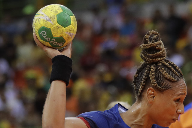 France's Beatrice Edwige tries to score during the women's preliminary handball match between Netherlands and France at the 2016 Summer Olympics in Rio de Janeiro, Brazil, Saturday, August 6, 2016. (Photo by Matthias Schrader/AP Photo)