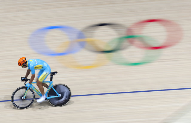A member of the Kazakhstan men's track cycling team rounds the track during a training session inside the Rio Olympic Velodrome during the 2016 Olympic Games in Rio de Janeiro, Brazil, Tuesday, August 9, 2016. (Photo by Patrick Semansky/AP Photo)