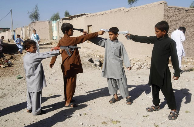 Afghan boys play with toy guns on the first day of Eid al-Adha in Jalalabad October 15, 2013. (Photo by Reuters/Parwiz)