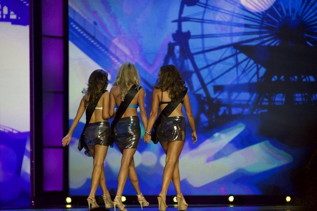 Contestants exit the stage after failing to advance in the Miss America Pageant in Atlantic City, New Jersey, September 13, 2015. (Photo by Mark Makela/Reuters)