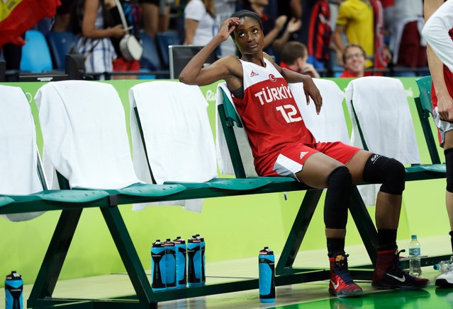 Turkey's Lara Sanders sits on the bench after a quarterfinal round basketball game loss to Spain, August 16, 2016. (Photo by Charlie Neibergall/AP Photo)