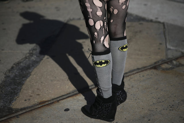 "A woman dress as the character ""Cat Woman"" stands outside the New York's Comic-Con convention, October 9, 2014. (Photo by Shannon Stapleton/Reuters)"